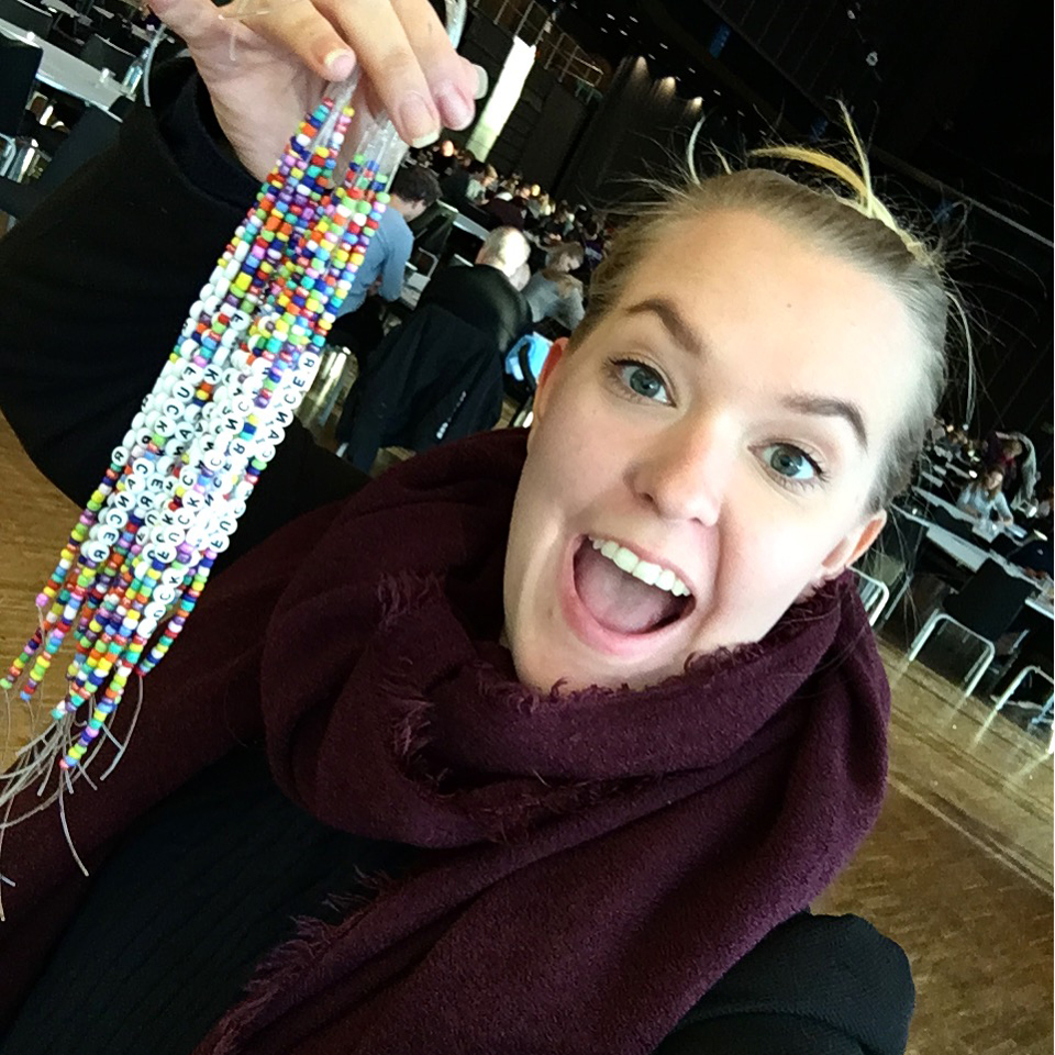 happy-girl-making-fuck-cancer-bracelets-for-ung-cancer
